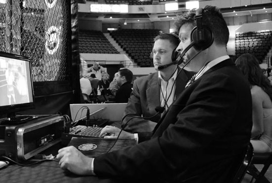 Jay (right) commentating at a recent MMA event.