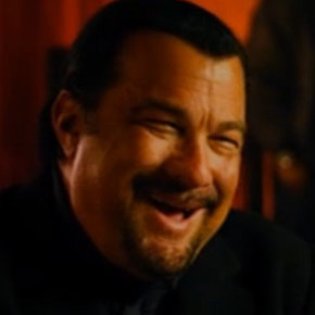 Steven Seagal is bad at laughing but loves his guns